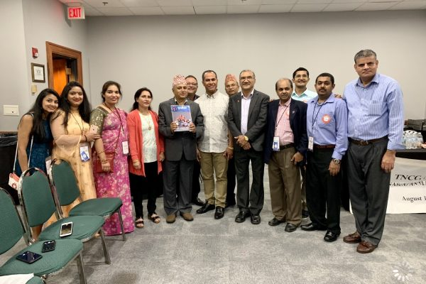 Handing over Punarjeevan to Nepal's former Health Minister Khagaraj Adhikari at NASeA/ANMA joint convention Winston-Salem, NC, Aug-31, 2019