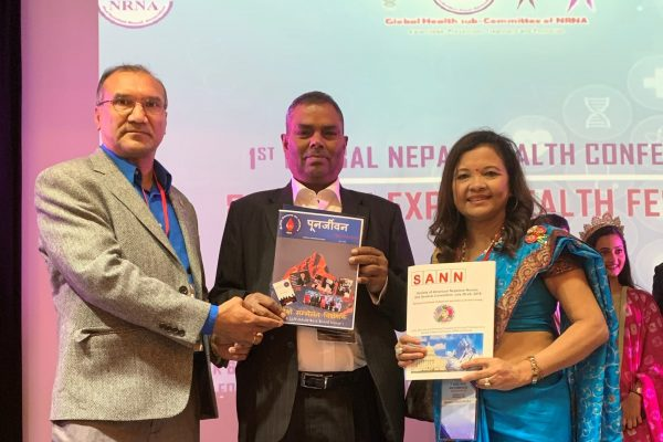 Punarjeev and SANN souvenir to Nepal's Health Minister Upendra Yadav at NRNA Health Conference, Atlanta, GA, Sep-22-2019